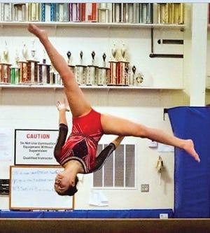 Isa Highfield displays her style on the balance beam.