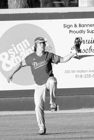Dewey High center fielder Jack Davis makes a tough catch during Tuesday's battle against the Bartlesville High junior varsity.