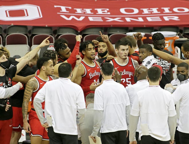 The Ohio State Buckeyes convene in a huddle during Sunday's NCAA Division I Big Ten conference basketball game against the Iowa Hawkeyes at Value City Arena in Columbus, Ohio, on February 28, 2021. Iowa won the game 73-57.