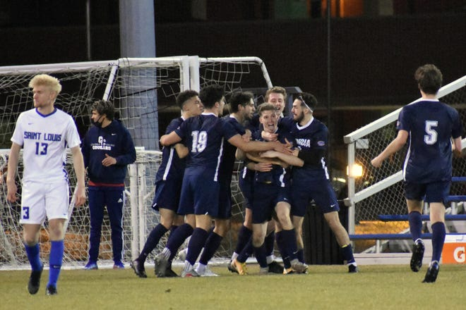 Columbia College players swarm Jake Totty (27) after he scored the Cougars' lone goal during a road game against Saint Louis on Tuesday night at Hermann Stadium.