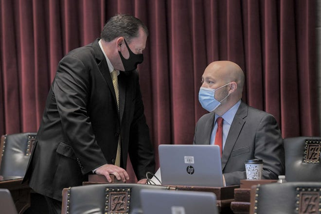House Speaker Rob Vescovo, R-Arnold, speaks with House Budget Chairman Cody Smith, R-Carthage, during the Nov. 10, 2020 special session.