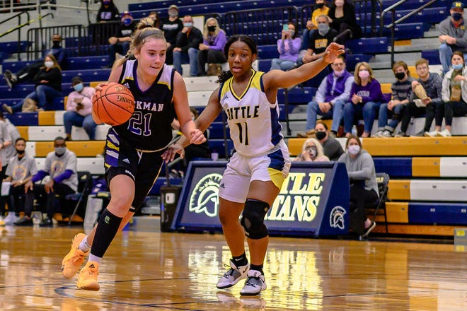 Hickman's Ashtyn Klusmeyer (21) drives past Battle's Imani Hopkins (11) during a Class 6 District 8 semifinal Tuesday night at Battle High School.