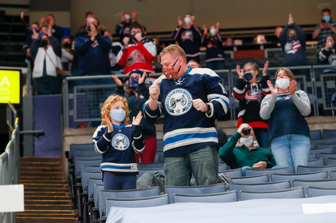 Blue Jackets fan Steve Christine and his daughter Maggie celebrate a goal by Cam Atkinson at Nationwide Arena on Tuesday.