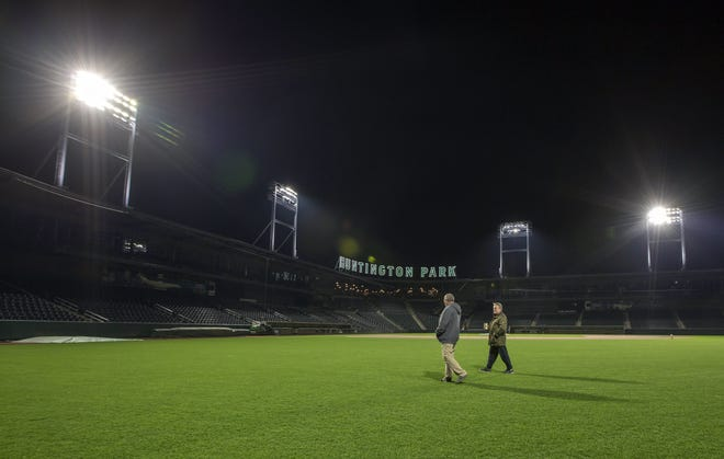 Clippers general manager Ken Schnacke, right, walks across the field at Huntington Park last April with Rob Mirus, a subcontractor for Musco Sports Lighting.