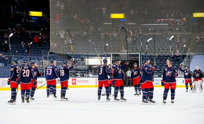 Blue Jackets players salute the fans following their 4-1 win over the Red Wings at Nationwide Arena on Tuesday.