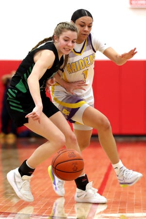 Jenna Kopyar, left, of Dublin Coffman, and Reynoldsburg's Mya Perry battle for possession during the Shamrocks' 60-57 win Tuesday in a Division I regional semifinal.
