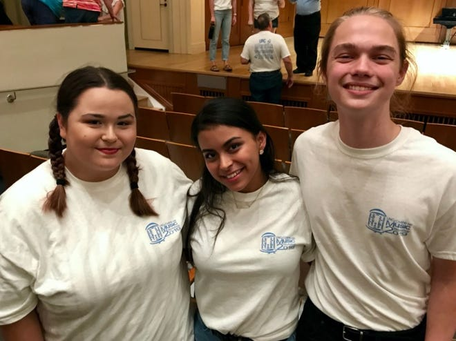 Pictured, from left, are Laci Burt, Jennifer Trejo Benitez and Conrad Suits after their cabaret performances at the 2019 UNC Music Workshop in Chapel Hill. The cabaret is one of two major public performances held each year at Hill Hall during the weeklong workshop for vocalists and pianists.