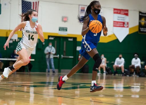Asheboro's Diamond McDowell drives down the court against Northwood. [Todd Turner for The Courier-Tribune]