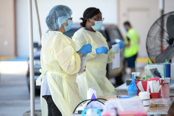 Health care workers conduct testing for COVID-19 in 2020 at Lake-Square Mall in Leesburg. [Cindy Peterson/Correspondent]