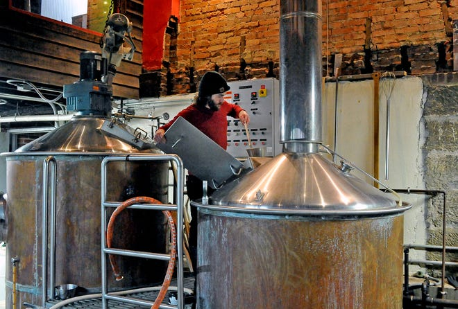 Derek Keck checks out a batch of Tangilicious beer in the making at the MIllersburg Brewing Co. It will be canned in about three weeks. The Millersburg Brewing Co. is one of 15 stops on the Hall of Fame Hops Brew Trail that begins March 15 and runs through November 7.