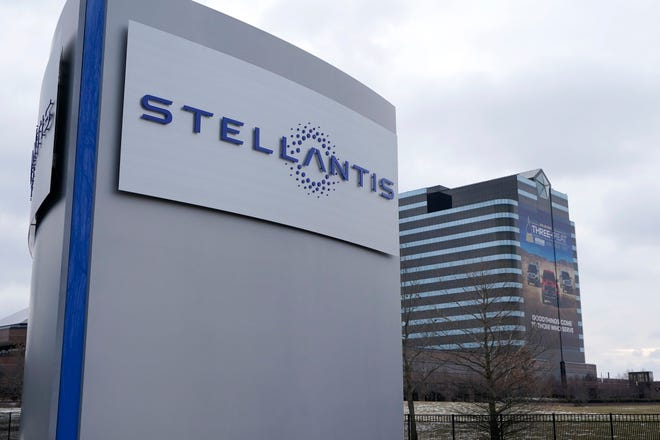 The Stellantis sign is seen outside the Chrysler Technology Center, Tuesday, Jan. 19, 2021, in Auburn Hills, Mich. Carlos Tavares, the CEO of Stellantis, the carmaker created from the merger of PSA Peugeot and Fiat Chrysler, said Tuesday that the tie-up will help preserve jobs, factories and the 14 storied brands as billions in annual savings are achieved. [AP Photo/Carlos Osorio]
