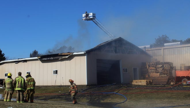 A pallet building in Morenci was destroyed Wednesday afternoon by a fire that started in the attic. Fire departments were able to prevent the fire from spreading into an adjacent building.