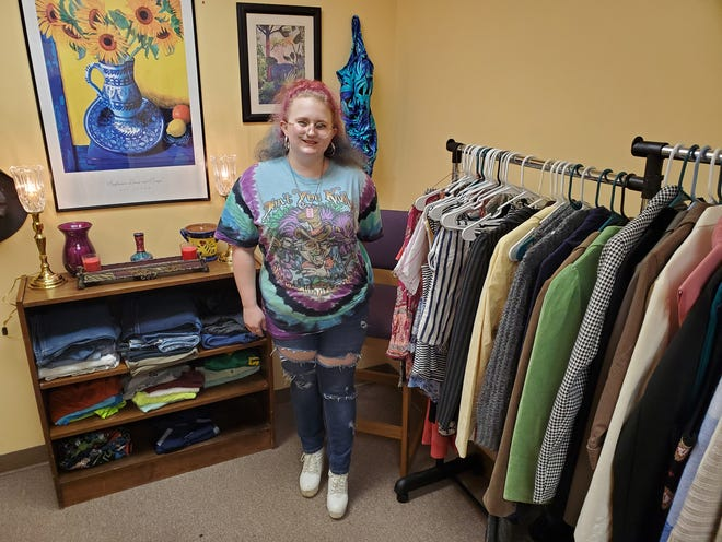 Gabriella Curtain stands in the Get REAL Boutique, a clothing closet she and fellow student Chloe Sutton (not pictured) began to help classmates in need on the Davidson-Davie Community College campus on East First Avenue Extension.