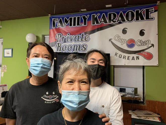 SaeHee Martin, center, runs Chop Chop Korean Restaurant and Chop Chop Karaoke in South Daytona with the help of her son Paul, right, and her brother DaeHaeng Cho, pictured on Tuesday, March 2, 2021. Business has been hurt by the coronavirus pandemic. The family has also experienced increased harassment in recent months from people blaming Asians for COVID-19.