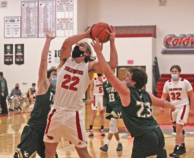 Coldwater big man AJ Rzepka (22) goes up strong in the paint during the Cardinals rout of Lumen Christi Tuesday night