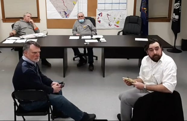 Travis Rivera, at right, owner of Black & Brass Coffee Roasting Co., and his consultant, John O'Reilly, listen to information offered by Palmyra Township Zoning Officer Paul Natale (not shown), at the March 1 supervisors' meeting. Seated in back are supervisors Pete Steffen and Joe Kmetz.