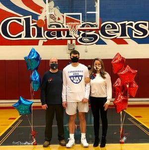 Carbondale Area boys basketball star Raymond Ofner was one of seven graduating players and cheerleaders honored at this year's Senior Night. Ray is pictured here with his parents during the pre-game ceremony at Peter Turonis Memorial Gym.