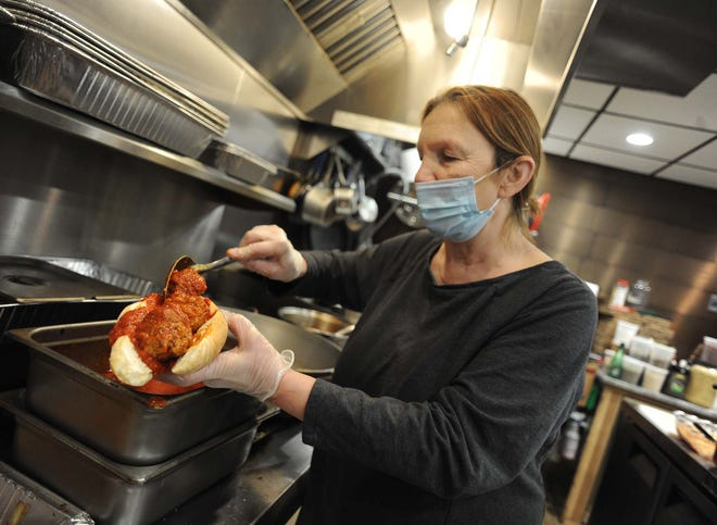 Rosa Galeno, owner of Rosa's Food Shoppe in Easton, makes her signature meatball sandwich on Wednesday, March 3, 2021.