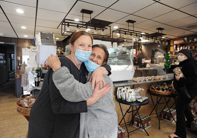 From left, Rosa Galeno, of Rosa's Food Shoppe, gets a hug from customer Agnesina Cimildoro, on Wednesday, March 3, 2021.