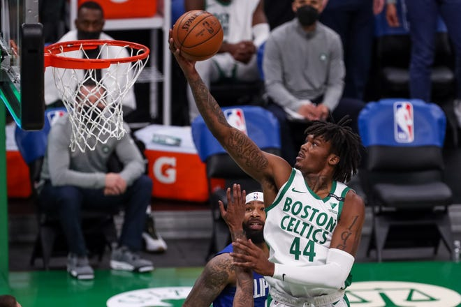 Boston Celtics center Robert Williams III (44) goes to the basket during the first half of Tuesday's game against the Los Angeles Clippers at TD Garden.