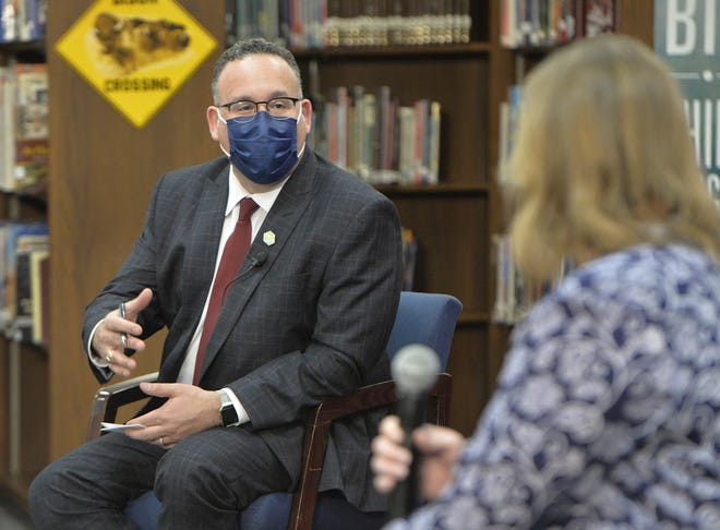 U.S. Education Secretary Miguel Cardona talks with Fort LeBoeuf Middle School teacher Laura Friedman about safely returning to schools on March 3, 2021, in Waterford, Pa., during a visit with first lady Jill Biden.
