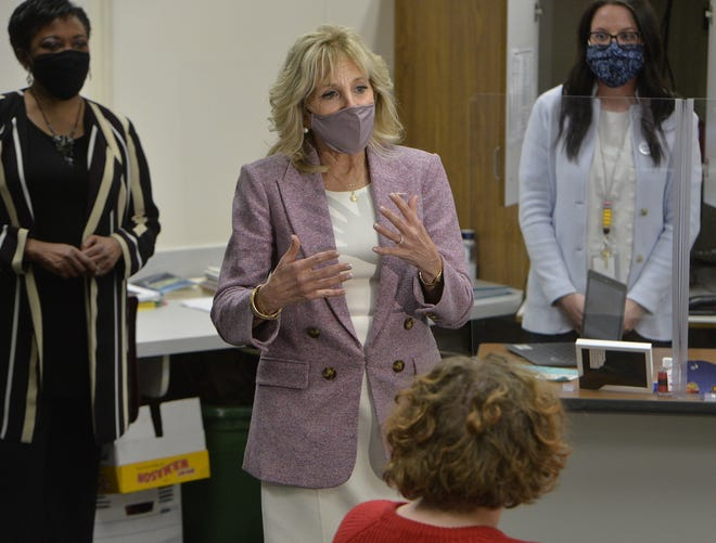First lady Jill Biden talks to Fort LeBoeuf Middle School students while touring classrooms on March 3, 2021, in Waterford, Pa. She is flanked by Becky Pringle, National Education Association president, left, and teacher Marlee Jones.