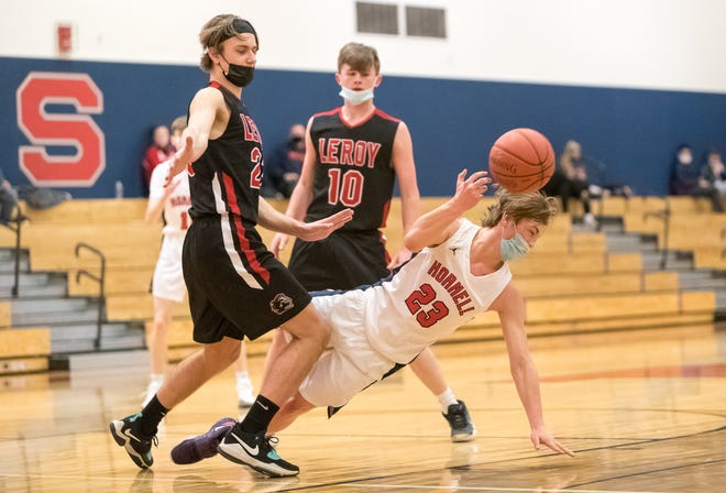 Hornell's Noah Kraatz braces for impact with the hardwood as he splits a pair of defenders on Tuesday night.