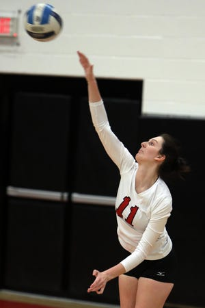 Southeastern Community College's Salena Sayre (11) serves the ball during the first game of their match against Kirkwood Community College, Tuesday March 2, 2021 at SCC's Loren Walker Arena.