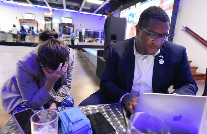 Daniel Henry, chair of the Duval Democratic Party, and a party volunteer look over 2018 midterm election results as the Florida Democratic candidate's lead slips away November 6, 2018.