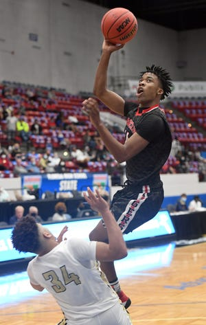 Andrew Jackson's Jackie Simmons III shoots against Bishop McLaughlin's Emanuel Sharp during their Class 3A semifinal in the Florida High School State Championships at The RP Funding Center in Lakeland on Wednesday. Bishop McLaughlin defeated Jackson 79-71 to advance. Simmons had a team-high 15 points.