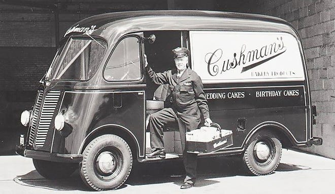 The familiar sight of the Cushman baker, carrying his basket of goodies, emerges from his delivery truck.