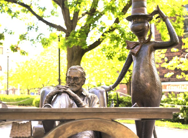 A statue of Theodor Seuss Geisel, known as Dr. Seuss, and his character the Cat in the Hat at The Amazing World of Dr. Seuss Museum in Springfield, Ma.