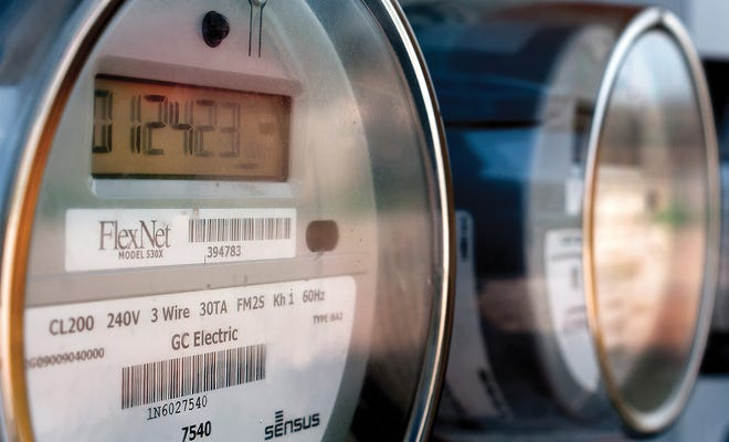 Digital electric meters run for a group of Garden City residences.