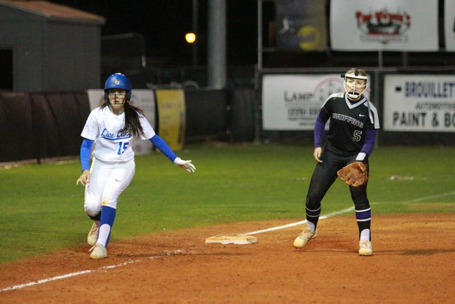 Dutchtown's Madi Mitchell (right) and Live Oak's Jenae Adams (left). Adams was 3-3 with a walk and two RBIs in the Lady Eagles' 15-4 win.