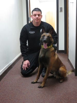 Denison Police Sgt. William Deering poses for a photo next to Officer Ivar in this file photo from 2014. The city council approved an agreement transferring ownership of Ivar to Deering, effectively retiring the police dog after seven years.