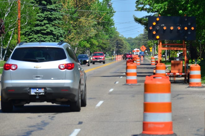 In this 2014 file photo, construction blocks off one lane on Ottawa Beach Road.  Improvement projects are planned in the greater-Holland area for spring and summer of 2021.