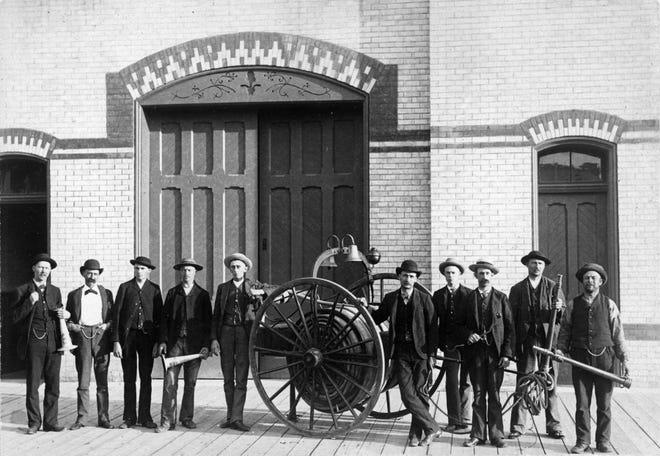 Firemen of Holland Fire House No. 2, Holland, circa 1886. From left: Hermanus Vaupell, Frederick O. Nye, Fred Klaasen, James Cook, John A. Pieters, John G. Dinkeloo, Elias Beeker, Pieter Moes, John Kruizenga, Mr. Jansen.