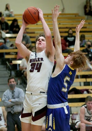 Buhler's Jack Voth (34) shoots past Nickerson's Brayden Miller (5) during their Class 4A Sub-State game Tuesday. Buhler defeated Nickerson 66-53 and advances to the sub-state championship game Friday. Voth was the team's high scorer with 24 points. To see more photos from the game, go to www.hutchnews.com/sports