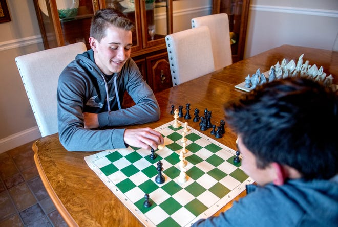 Lucas Rassi, left, and his brother Isaac, both 17, spend some competitive time together playing chess at their home in Morton. Rassi has been involved in the Tazewell County Chess Tournament since he was a grade-schooler and now volunteers and coaches at the event for grades 3-8. For the first time in its 43-year history, the annual tournament was canceled because of the pandemic.