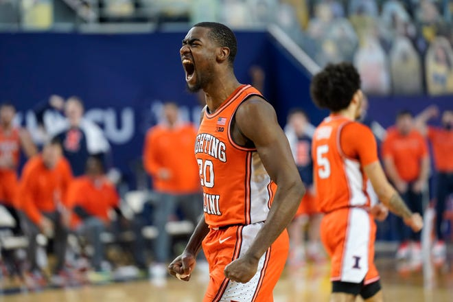 Illinois guard Da'Monte Williams (20) reacts to a play against Michigan in the first half of an NCAA college basketball game in Ann Arbor, Mich., Tuesday, March 2, 2021.