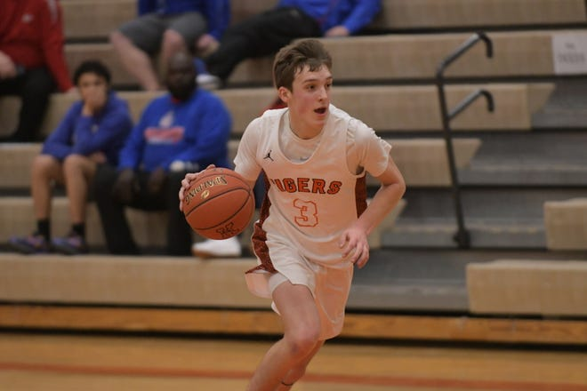 Kirksville's Ike Danielson crashes into the paint Tuesday against Moberly.