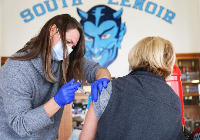 A Lenoir County Public Schools staff member receives the Moderna vaccine Wednesday, March 3, at South Lenoir High School.