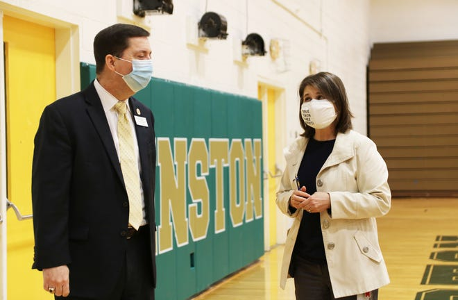 Lenoir County Public Schools superintendent Brent Williams talks with Lenoir County Health Department director Pamela Brown Tuesday, March 3, at Kinston High School while LCPS staff receive the Moderna vaccine.