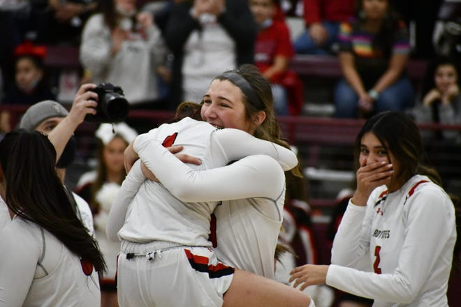 Lubbock-Cooper's Bella Sipowicz (center) and Catalina Cortez (1) hug after beating Plainview, 78-58, in the Class 5A regional finals on Tuesday, March 2, 2021 in Littlefield, Texas
