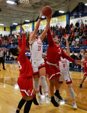 Shallowater's Bree Brattain (23) hauls in a rebound in a Region I-3A final game, Tuesday, March 2, against Brownfield at Frenship High School's Tiger Pit.