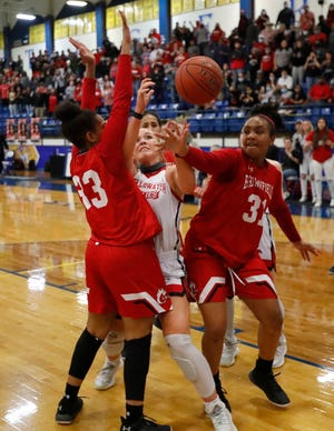 Brownfield's Deja Johnson (33) and Tia Johnson (31) fight for a rebound with Shallowater's Bree Brattain (23) in a Region I-3A final game, Tuesday, Mar. 2, 2021 at Frenship High School's Tiger Pit. [Mark Rogers/For A-J Media]