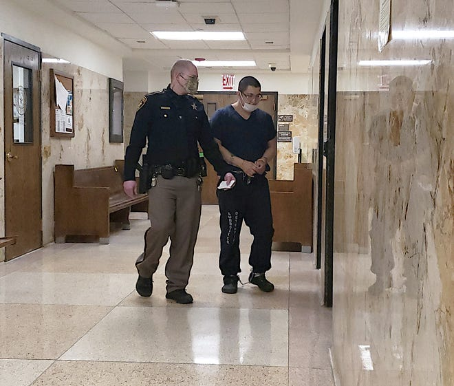 Andrew Ybaben is escorted out of the 137th District Court where he was sentenced to 43 years in prison for sexually abusing a girl in 2019.