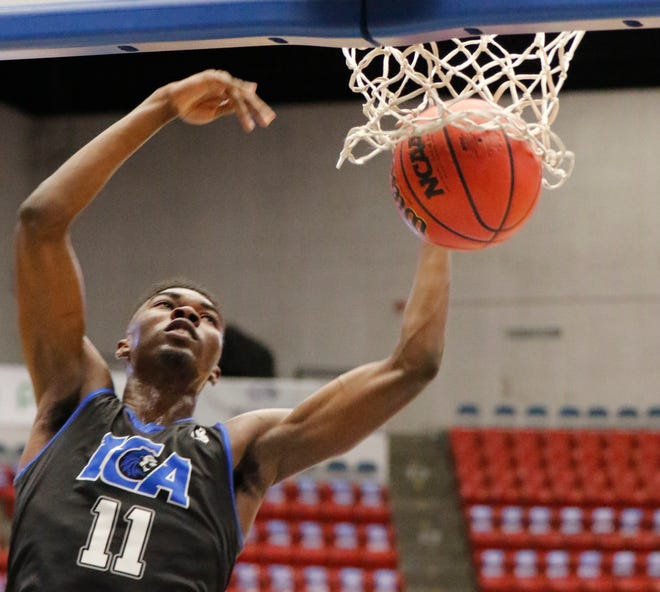 Impact Christians Calvin Johnson dunks in a breakaway in the fourth quarter of the FSHAA Class 2A Boys State semifinal against Southwest Florida Christian on Wednesday at The RP Funding Center in Lakeland.
