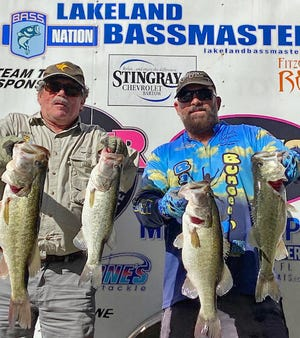 Steve Swauger, left, and Anthony Papania had 20.22 pounds and a big bass weighing 6.93 pounds to win the Lakeland Bassmasters Team Trail tournament Feb. 27 on the Harris Chain of Lakes.