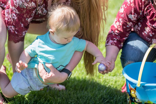 A child picks up an egg at the 2019 Osage Beach egg hunt.